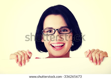 Portrait young happy woman with blank board.