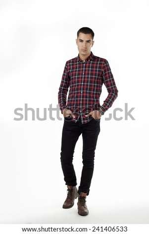 Portrait young male ffashion model in wear in studio