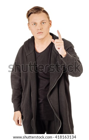 portrait young man pointing up, showing something, having an idea. emotions, facial expressions, feelings, body language, signs. image on a white studio background. - stock photo