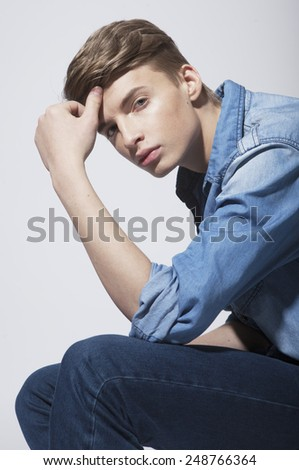 Portrait young man, wearing in  jeans shirt ,hipster