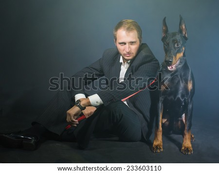 Portrait young men with a dog - stock photo