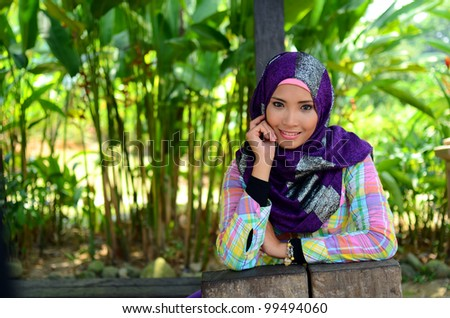 Portrait young muslim women relaxed at the park with lovely smile