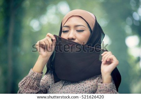 Portrait young muslim women wear traditional thai, She Feel happy