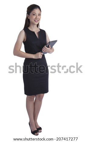 Portrait young pretty businesswoman in office attractive standing using a tablet smilling and happiness