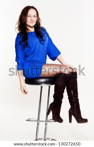 Portrait ? young smiley beautiful woman sitting on chair - stock photo