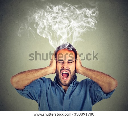 Portrait young stressed man screaming frustrated overwhelmed steam coming out up of head isolated on grey wall background. Negative human face expression emotion feelings  perception - stock photo