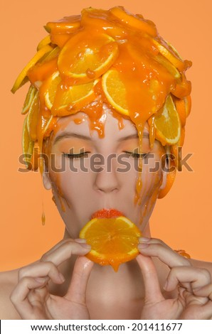 Portrait young woman in cap of oranges