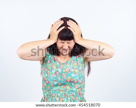 Portrait  young woman keeps for sick head. Headache, migraine, stress.     - stock photo