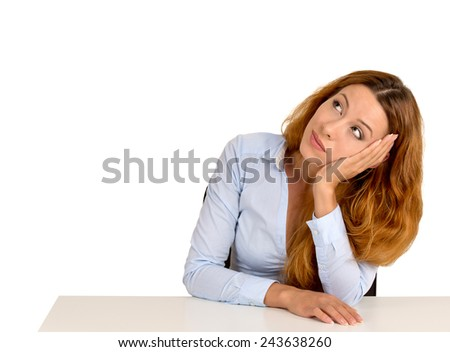 Portrait young woman leaning on a desk, thinking looking up isolated on white background with copy space   - stock photo