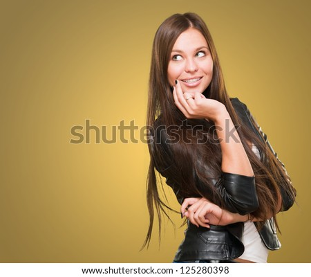 Portrait Young Woman Smiling against a yellow background - stock photo