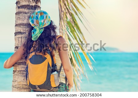portrait Young woman with backpack enjoying sunny day. Travel to Asia, happiness emotion, summer holiday concept - stock photo