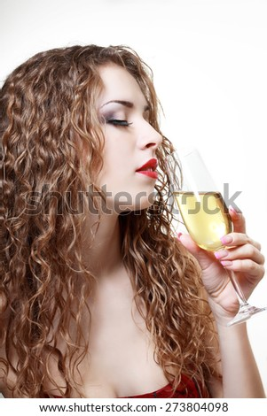 Portrait young woman with glass of champagne