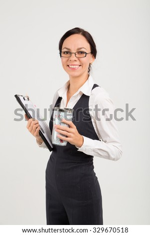 portraite of office woman with pad and cup