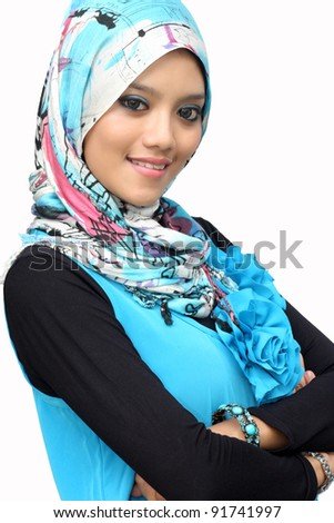 Portraits of young muslim woman smiling over white background