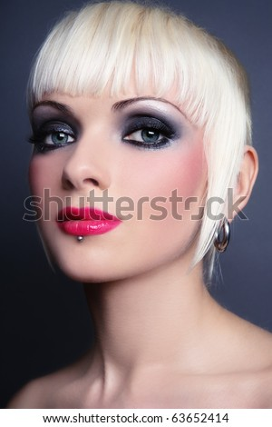 Portraits of young sexy blond girl with stylish make-up