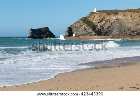 Portreath pier beach shore waves, Cornwall England. - stock photo