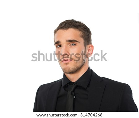 portret of young man in black suit - stock photo