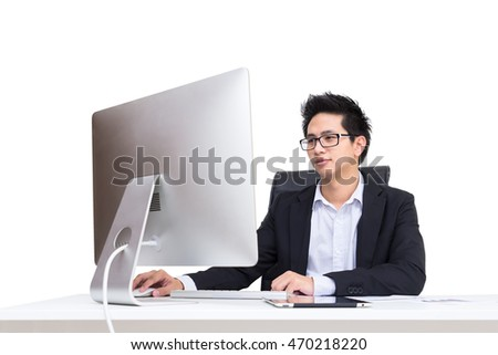 Portrial smart asian confident businessman sitting on chair working by computer, have document and tablet and smartphone on desk