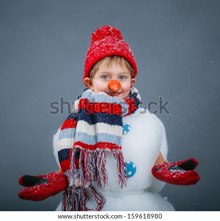 Portrite of cute little boy in suit snowman in red hat and mittens - stock photo