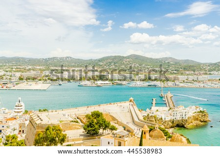 Ports of Ibiza. Landscape of Ibiza city, boat, sea and blue sky. Color and horizontal composition at summer.