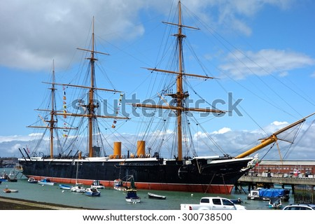 PORTSMOUTH, ENGLAND - JUNE 5. The Portsmouth Historic Dockyard contains HMS Warrior, a warship built in 1860, on June 5, 2015, Portsmouth, England. - stock photo