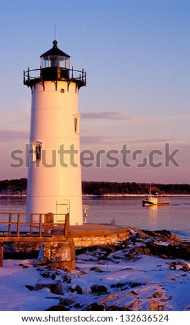 Portsmouth Harbor lighthouse guides fishermen during the winter months into Portsmouth Harbor. - stock photo