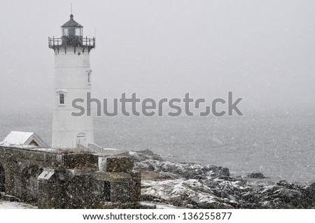 Portsmouth Harbor Lighthouse in snowstorm on the New Hampshire coast.