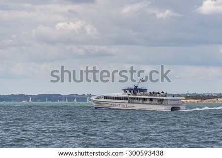 PORTSMOUTH, UK - JULY 25: A Wight Link catamaran fast passenger ferry sailing across the Solent between Portsmouth and the Isle of Wight shown on July 25, 2015 in Portsmouth, UK