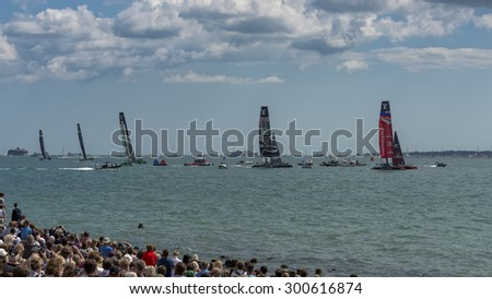 PORTSMOUTH, UK - JULY 25: The Team Emirates, Land Rover BAR, Groupama, Team Oracle, and Softbank boats sailing in the America's Cup World Series in Portsmouth shown on July 25, 2015 in Portsmouth, UK - stock photo