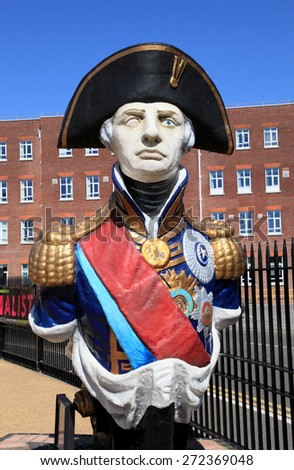 PORTSMOUTH, UK - JUNE 12, 2014: Statue of Admiral Lord Nelson on June 12, 2014 in Portsmouth, UK. The statue is displayed in Portsmouth historical dockyard to commemorate this national hero. - stock photo