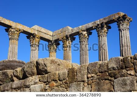 Portugal, Alentejo Region, Evora historic center. Granite stone columns of Diana's Temple - Roman remains UNESCO World Heritage site. (selective focus - on columns) - stock photo