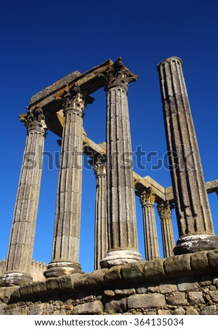 "Portugal, Alentejo Region, Evora, Historic centre. Granite stone columns of Diana's Temple - ""Templo Roamano"" Roman remains UNESCO World Heritage site"