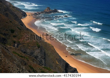 Portugal, Algarve Region, Vila do Bispo, South-West Alentejo and Vicentine Coast Natural Park. Cliff top view of the waves washing onto Cordoama Beach.