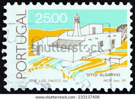 """PORTUGAL - CIRCA 1985: A stamp printed in Portugal from the """"Traditional Architecture """" issue shows Sitio house, Algarve, circa 1985.  - stock photo"""