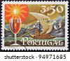 PORTUGAL - CIRCA 1970: A stamp printed in Portugal shows Transfer Port Wine by the River, circa 1970 - stock photo