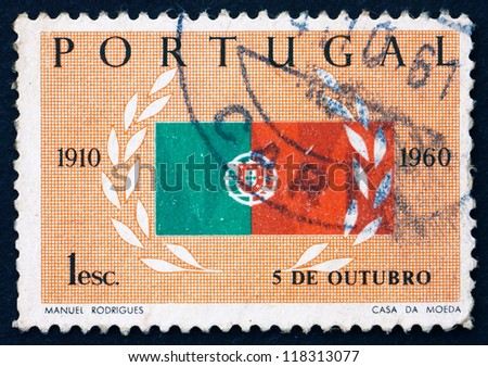 PORTUGAL - CIRCA 1960: a stamp printed in the Portugal shows Flag and Laurel, 50th Anniversary of the Republic, circa 1960