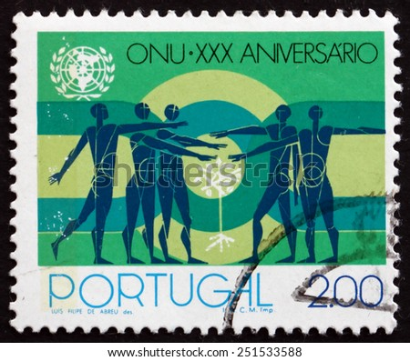 PORTUGAL - CIRCA 1975: a stamp printed in the Portugal shows People and Sapling, United Nations, 30th Anniversary, circa 1975 - stock photo