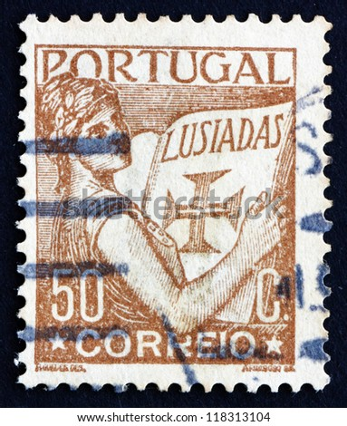 PORTUGAL - CIRCA 1931: a stamp printed in the Portugal shows Portugal Holding Volume of Lusiads, Allegory, circa 1931