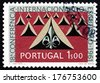 PORTUGAL - CIRCA 1962: a stamp printed in the Portugal shows Tents and Scout Emblem, 50th Anniversary of the Portuguese Boy Scouts, circa 1962 - stock photo