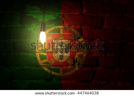 Portugal flag on a brick wall lit by a lamp - stock photo