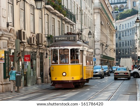 PORTUGAL, LISBON - OCTOBER 07: Yellow Tram in Lisbon on October 07, 2013. Yellow  Trams are the symbol of the city. In operation since 1873