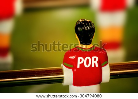 Portugal National Jersey on Vintage Foosball, Table Soccer or Football Kicker Game, Selective Focus, Retro Tone Effect - stock photo