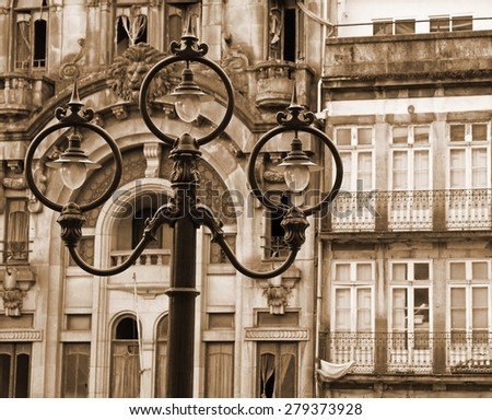 Portugal. Porto city. Ancient lantern opposite old house. In Sepia toned. Retro style  - stock photo