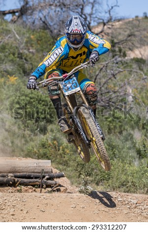 PORTUGAL - SAO BRAS DE ALPORTEL, March 15th 2015: 1st stage - Portuguese Cup - Downhill competition, Biker rides fast in the countryside.