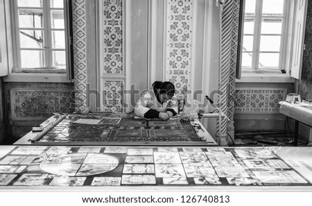 Portugal, Sintra, Pena Palace, a restorer working on an original mosaic glass window