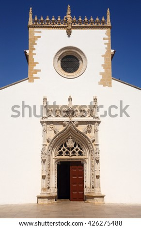 Portugal, Tomar. Facade of the Church of Saint John the Baptist, built between 15th and 16th Centuries in the city which was the historical headquarters of the Knights Templar. UNESCO World Heritage. - stock photo
