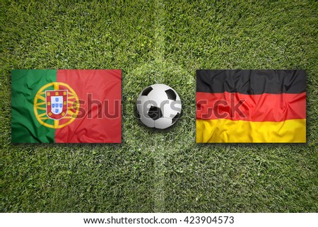 Portugal vs. Germany flags on a green soccer field