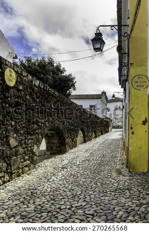 Portuguese Alentejo city of Evora, old town, partially enclosed by medieval walls, as a large number of monuments, from various historical periods, including a Roman Temple, UNESCO World Heritage Site - stock photo