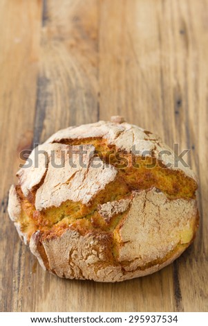 portuguese bread on brown wooden background - stock photo
