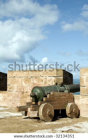 Portuguese cannons at the protective ramparts wall skala de ville in essaouira morocco Africa